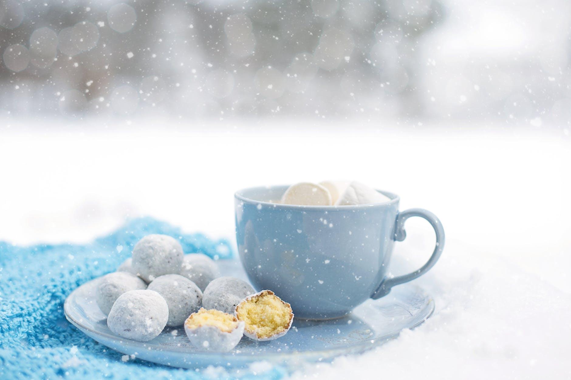 pastries near blue ceramic mug on round plate