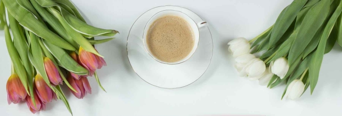 cafe latte on a white ceramic tea cup